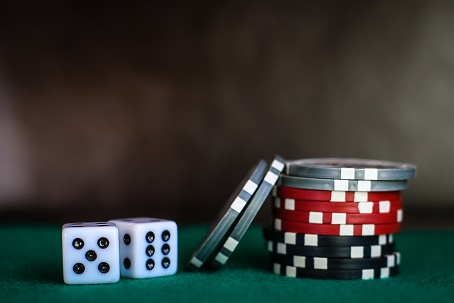 stack of gambling chips and dice