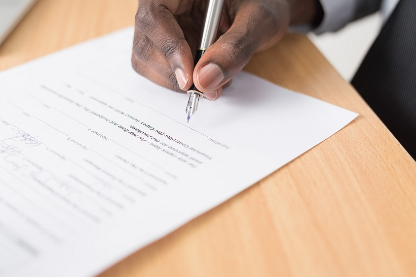signing a business license