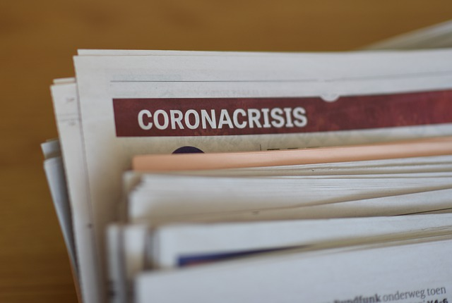 stack of documents for filing with the coronavirus tab pulled out